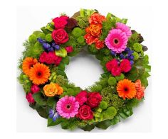 Vibrant Wreath :  A gloriously vibrant wreath. Cerise and orange Roses and Carnations with orange Germini, purple Anconitum and green spray Chyrsanthemums on a sumptuous green foliage base.
