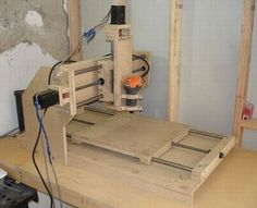 CNC Router by Iraklis Gkolios -- Homemade CNC router constructed from wood, steel rods, leadscrews, stepper motors, and a rotary tool. http://www.homemadetools.net/homemade-cnc-router-15