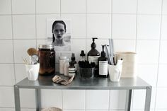j. levau blog | Bathroom perfection - love the white basic tiles, the steel shelf and beauty stuff