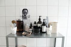 j. levau blog   Bathroom perfection - love the white basic tiles, the steel shelf and beauty stuff