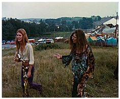 Janis Joplin and Peggy Caserta heading somewhere through the field.