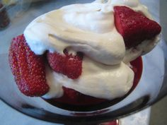 This recipe was in the Houston paper. I go to La Madeleine just for Strawberries Romanoff. SO  GOOD! Very easy to make...my 11 year old son makes it.