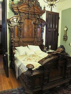 Bed from bedroom set manufactured in Louisville, Kentucky by the J.W. Davis Co. and exhibited at the Philadelphia Centennial of 1876.  In the Thomas Brennan house in Louisville.