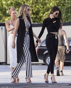 Girl talk: (L-R) Karlie Kloss, Gigi Hadid and Kendall Jenner looked particularly stylish a...