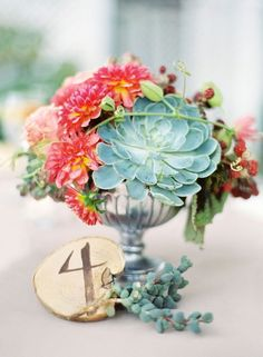 This unique centerpiece is packed with succulents, berries and flowers.