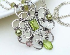 Wire wrap necklace, green peridot necklace, sterling silver cross necklace