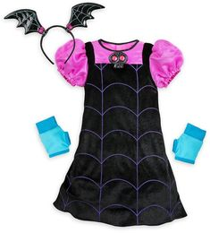 Your ghoul will go batty for dressing up as Vee! This velvet Vampirina costume features a bat ear headband, gloves, and a skull that sings the Vampirina song. Toddler Costumes, Girl Costumes, Halloween Costumes, Children Costumes, Disney Halloween, Funny Halloween, Halloween 2020, Kids Party Decorations, Black Velvet Dress