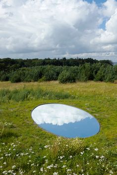 olafur eliasson: elliptical mirrors, representative of glacial basins