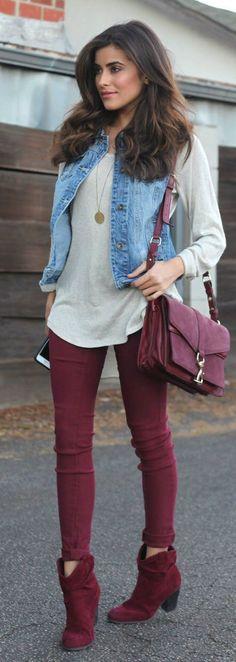 Shop this look on Lookastic: https://lookastic.com/women/looks/vest-oversized-sweater-skinny-jeans/14404 — Grey Oversized Sweater — Gold Pendant — Blue Denim Vest — Burgundy Leather Crossbody Bag — Burgundy Skinny Jeans — Burgundy Suede Ankle Boots