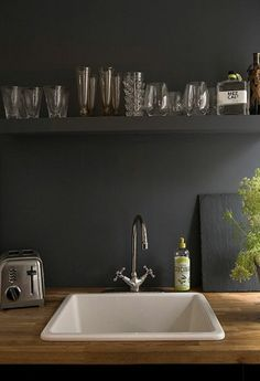 I prefer the look of a porcelain sink with wooden countertops rather than stainless steel sinks.