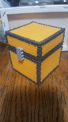 This is a small perler Minecraft chest. Great for car keys and change or anything you can think of. Opens and closes with hinges. Battery is only used as a size comparison. Easy Perler Bead Patterns, Melty Bead Patterns, 3d Perler Bead, Perler Bead Templates, Pixel Art, Hamma Beads Ideas, Nerd Crafts, Peler Beads, Hama Beads Minecraft