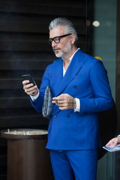 Taan says: Gentleman pulling off a cobalt blue suit from top to bottom. But I believe you really need a good amount of grey hair on your head, otherwise this look might not work :-)