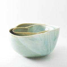 """porcelain dart bowl. approx 10"""" wide, 4.5"""" high. sizes vary.wheel thrown, then very hand-altered to give and organic shape. glazed glassy dark and light greens. each bowl has its own unique markings.food/microwave safe. handwash preferable.our products are made in the wabi sabi tradition. crazing, irregular textures and marks are part of the handmade nature of the work, and should be embraced"""