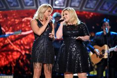 Miranda Lambert Photos Photos - Recording artists Miranda Lambert (L) and Kelly Clarkson perform onstage during the 2014 American Country Countdown Awards at Music City Center on December 15, 2014 in Nashville, Tennessee. - American Country Countdown Awards Show
