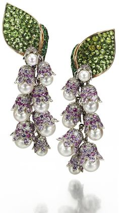 Lily of the Valley Earrings in yellow and white gold, set with 18 Akoya pearls, 544 purple sapphires, 152 green garnets, 330 diamonds and 36 emeralds, by Suzanne Syz.  Via The Jewellery Editor.