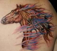 This horse tattoo shows feathers in the horses mane in a Native American style