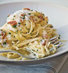 Carbonara pasta - Alfredo sauce, peas, bacon bits, Parmesan cheese