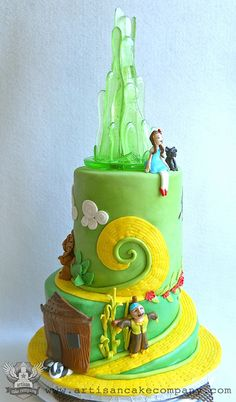 Alice in Wonderland cake by the 'ArtisanCakeCompany' on flickr. I love how the yellow brick road in is interpreted at the top.