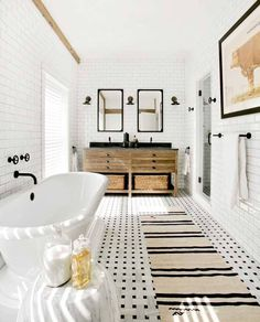 Bright bathroom whose walls are lined with subway tiles in this home located in Sag Harbor NY