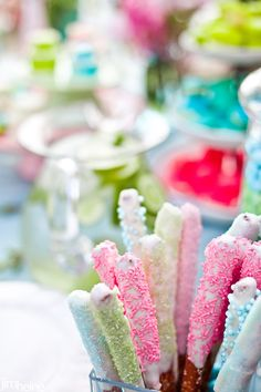 Chocolate dipped pretzels with sprinkles. So easy and pretty for a sweet table.