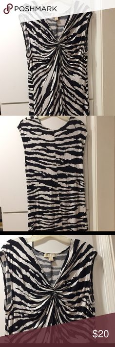 Zebra print sleeveless dress Bold zebra print. Gathers in front below the v-neckline. Soft rayon spandex; great for travel. MICHAEL Michael Kors Dresses Midi