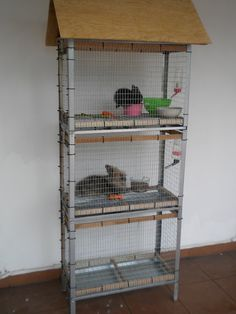 DIY rabbit hutch (((A good example with close up pictures on how to turn a shelving unit into cages.)))