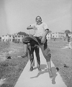 Boys playing leap frog near the project. Gordon Parks