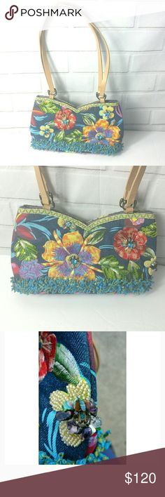 """MARY FRANCES Floral Artisan Shoulder Purse This beautiful purse for Mary Frances is hand-beaded by people in poor countries as a way to help raise money for families.  •piece of art  •  Shag at the bottom •handpainted flowers   •jeweled beading throughout. • good, clean condition.  •1 bead is missing and if you look at the straps one strap has a little wear.  •bottom if you see has a couple of marks which can be easily washed off.  •Look up Mary Frances' bags' inspiring story. About: 12""""…"""