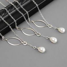 White pearl lariat necklace with an infinity link - perfect for bridesmaids necklaces.  SET OF 4 Wedding Jewelry - White Swarovski Pearl Bridesmaid Necklace - Sterling Silver Lariat - Infinity - Bridesmaid Gift - $130 -