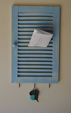 Shutter repurposed into an organisation hub - very cute. Put on a few hooks for keys ...