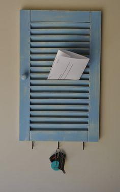 Shutter repurposed into an organisation hub - very cute. Put on a few hooks for keys ...