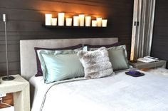 Simply Smitten by Kristin Kerr. Candles above the headboard. Love it