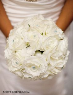 White rose bridal flower bouquet with blue gems.