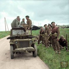 Invasion of Normandy 6 June 1944 Commandos of Special Service Brigade with captured Germans in a jeep, with gliders of Airlanding Brigade in the background, near Ranville, on the evening of 6 June Pin by Paolo Marzioli Ww2 Pictures, Military Pictures, Ww2 Photos, Cj Jeep, Jeep Willys, Jeep Wrangler, British Commandos, D Day Normandy, Normandy Ww2