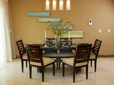 I love the lighting and the coziness of this dining room.  Round tables add to the intimate atmosphere.