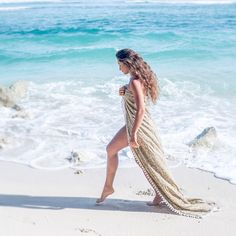 Morning stroll on the beach - LINDA HERING beach towel MELASTI with pompons #handmade #lindahering #madewithloveinbaliღ #wax #textiles #bali #threads #coloursofbali #unikat #melasti #instalike #manufacture #towelmelasti  #pompon #instadaily #beach #fashion #fashionista #igdaily #musthave #style #design #boutiques #beachtowel #shoponline #bali🌴 #sea #morning Pom Pon, Beach Fashion, Boutiques, Beach Towel, Bali, Cover Up, Textiles, Sea, Instagram Posts