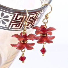 These gorgeous hand-painted red Lucite flower earrings are vibrant yet delicate, great for a pop of romantic red. These charming flower earrings are the perfect addition for a special occasion. Their