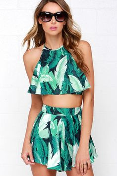 """Why leave your outfit up to chance, when you can be guaranteed chic with the Leaf it to Me Green Tropical Print Two-Piece Set! A vivid green tropical print covers the woven crop top of this flirty set, with a tying halter neckline, elasticized back strap, and a flouncy bodice. The matching shorty-shorts are topped with box pleats, and ruffle to a skirt-like finish. Shorts have exposed silver back zipper with clasp. Set is lined. Small top measures 13"""" long. Small bottom measures 13"""" long…"""