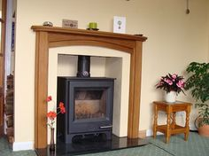 """The Arched Oak surround shown in made to measure sizes. """"Just to say again how pleased we are with the oak surround"""" - Mr Wilson Oak Fire Surround, Fireplace Surrounds, Solid Oak, Contemporary, Modern, Arch, Home Appliances, Wood, Photos"""