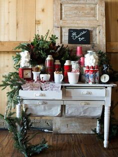 Cozy up at your winter wedding with a DIY hot chocolate bar. Add marshmallows and whipped cream on the side for a selection of delicious toppings.