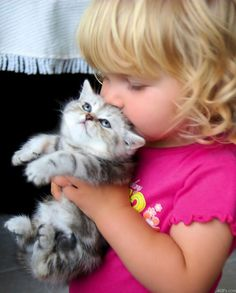 Oh my gosh....this was exactly me as a child...I always had a precious kitty in my hands and to this day, I LOVE baby kittens!  One of the cutest things in the world!