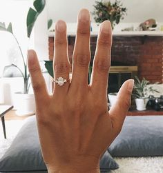 Past, present, and future. Congratulations @kayliberato! Thank you for sharing your beautiful three stone ring with us.  Link in bio to shop this style | Selene Diamond Ring #BrilliantEarth #regram #engaged #shesaidyes
