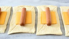 Rectangles of crescent dough, each topped with a slice cheese and a hot dog