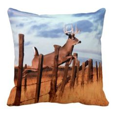 Trendy and pretty double sided throw pillow. With beautiful painting of deer jumping over country field fence on one side, and matching stripes on the other. For the deer or elk hunter, outdoors hunting sportsman, wild animal, wildlife, fall season and nature lover. Cute and fun gift for mom's or dad's birthday, Mother's or Father's day, or Christmas. Original art for the master or children's bedroom, living or family room, man cave, log cabin, beach house, country cottage, or vacation home.