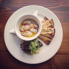 Marinated green shell muscles served with grilled flatbread