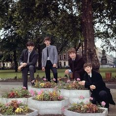 2nd July 1963. The Beatles take part in a Dezo Hoffman photo shoot in Russell Square, London.