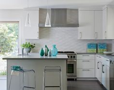 """White patterned tile kitchen backsplash in Tiburon Home by Shirley Parks Design Interior Designers & Decorators [Is this """"diamond dimensional"""" stretched hexagon by Heath Ceramics?]"""