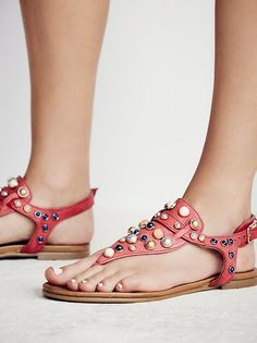 Strange Magic Sandal | Super soft leather slip-on sandals in a thong fit with an adjustable ankle strap and allover stone embellishments   Rubber sole.