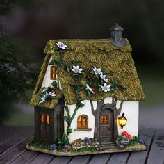 Fairy Homes and Gardens - Solar Flower Vine Roof Fairy Cottage, $45.99 (https://www.fairyhomesandgardens.com/solar-flower-vine-roof-fairy-cottage/)