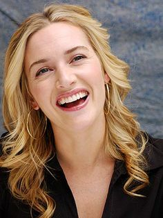Gorgeous...no airbrushing in sight, thank goodness! I love I can see her laugh lines!!